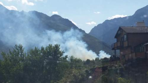 Courtesy of KUTV News A field fire in Cottonwood Heights forced some evacuations of homes on Tuesday.