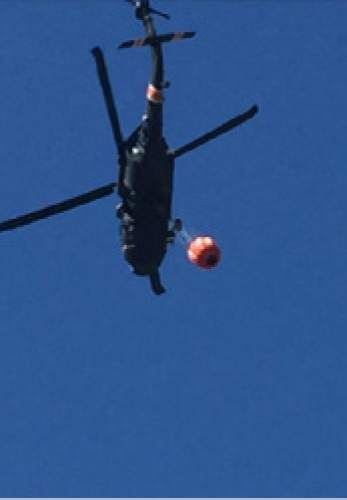 |  Courtesy Cottonwood Heights Police  Two National Guard Blackhawk helicopters were aiding efforts to fight a field fire in Cottonwood Heights on Tuesday afternoon.