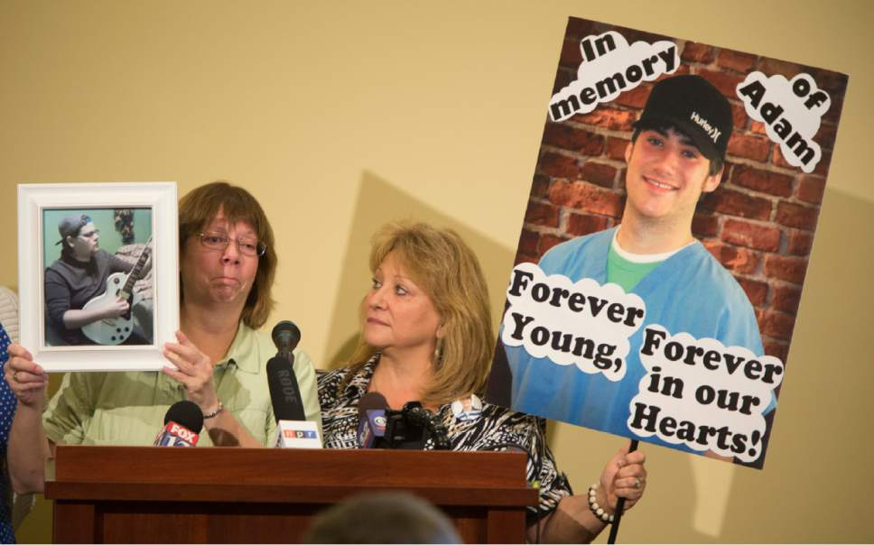 Rick Egan     The Salt Lake Tribune  Julie Skidmore holds a photo of her son Mathew, and Darlene Schultz holds a poster of her son Adam, at the FedUp Rally Utah, on International Overdose Awareness Day at the Utah State Capitol, Monday, August 31, 2015.