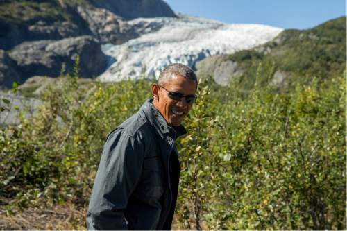 President Barack Obama speaks to members of the media while on a hike to the Exit Glacier in Seward, Alaska, Tuesday, Sept. 1, 2015, which according to National Park Service research, has retreated approximately 1.25 miles over the past 200 years. Obama is on a historic three-day trip to Alaska aimed at showing solidarity with a state often overlooked by Washington, while using its glorious but changing landscape as an urgent call to action on climate change. (AP Photo/Andrew Harnik)