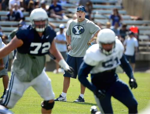 Scott Sommerdorf   |  The Salt Lake Tribune BYU head coach Bronco Mendenhall watches during practice, Saturday, August 22, 2015.