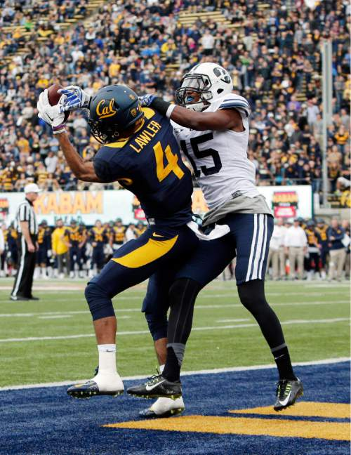 California wide receiver Kenny Lawler (4) makes a touchdown catch next to BYU defensive back Michael Davis during the first half of an NCAA college football game, Saturday, Nov. 29, 2014, in Berkeley, Calif. (AP Photo/Marcio Jose Sanchez)