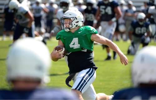 Scott Sommerdorf      The Salt Lake Tribune BYU QB Tayson Hill runs during practice, Saturday, August 22, 2015.