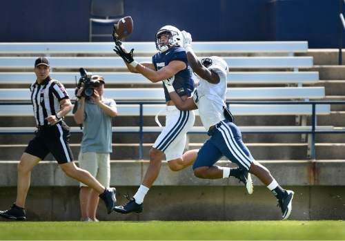 Scott Sommerdorf      The Salt Lake Tribune BYU WR Nick Kurtz hauls in this long pass from QB Taysom Hill during practice, Saturday, August 22, 2015.