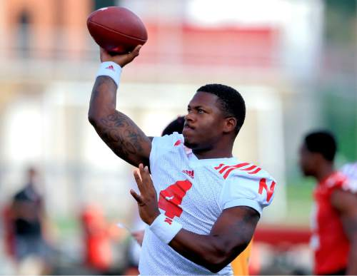 Nebraska quarterback Tommy Armstrong Jr. (4) throws during NCAA college football practice in Lincoln, Neb., Thursday, Aug. 6, 2015. (AP Photo/Nati Harnik)