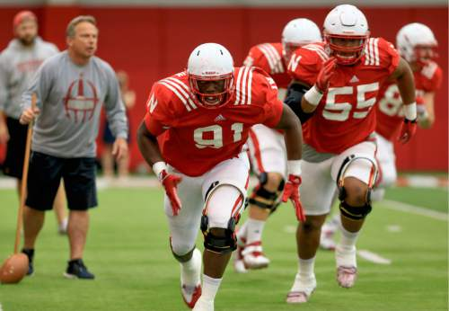 In this photo taken Aug. 18, 2015, Nebraska defensive end Freedom Akinmoladun (91) and defensive tackle Kevin Maurice (55) are followed by defensive coordinator Mark Banker, left,  during NCAA college football practice in Lincoln, Neb. Nebraska returns six defensive players with at least 10 career starts. (AP Photo/Nati Harnik)