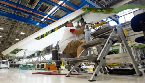 Steve Griffin     The Salt Lake Tribune  Mechanics work on a horizontal stabilizer for a Boeing 787 Dreamliner at Boeing in Salt Lake City, Thursday, September 3, 2015.