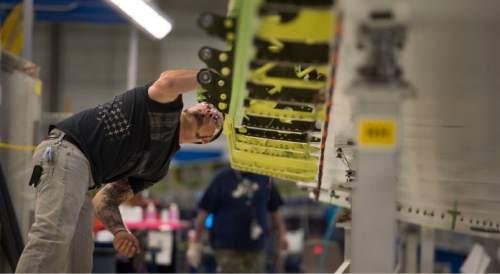 Steve Griffin     The Salt Lake Tribune  Mechanic T.J. Duran works on a horizontal stabilizer for a Boeing 787 Dreamliner at Boeing in Salt Lake City, Thursday, September 3, 2015.