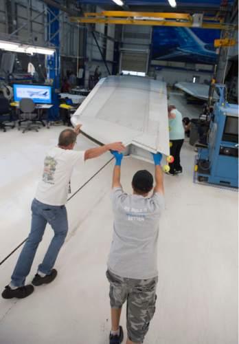 Steve Griffin     The Salt Lake Tribune  Mechanics push a vertical fin assembly for a Boeing 787 Dreamliner at Boeing in Salt Lake City, Thursday, September 3, 2015.