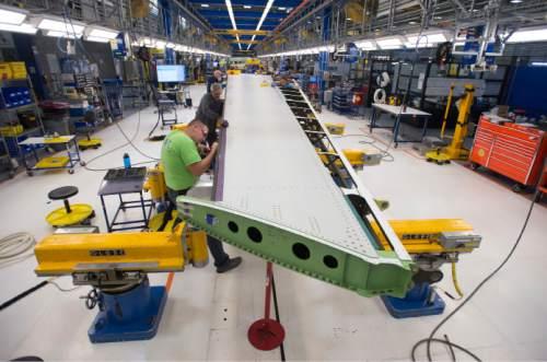 Steve Griffin     The Salt Lake Tribune  Mechanics work on a vertical fin assembly for a Boeing 787 Dreamliner at Boeing in Salt Lake City, Thursday, September 3, 2015.
