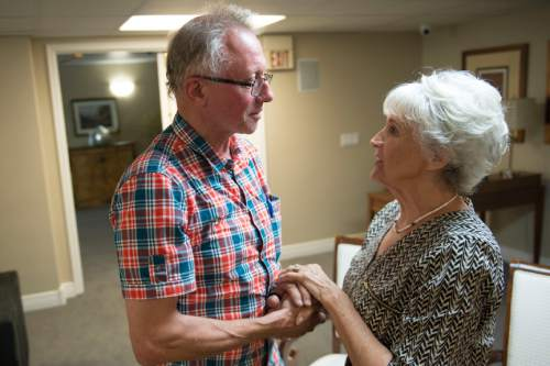 Jeremy Harmon  |  The Salt Lake Tribune  Rolf Hagglund, left, greets Marilyn Morrison-Ryan at an event where the two families met  in Salt Lake City on Sept. 4, 2015. Hagglund's grandfather was the brother of Joe Hill, who was convicted of killing Morrison's grandfather, John G. Morrison, in 1914.