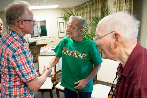 Jeremy Harmon  |  The Salt lake Tribune Merlin Morrison, center, and his cousin, John Arling Morrison, meet Rolf Hagglund during a gathering of the two families on Sept. 4, 2015. Hagglund's grandfather was the brother of Joe Hill. The Morrisons' grandfather was John G. Morrison. On January 10, 1914, John G. Morrison and his son Arling were murdered in Salt Lake City. Joe Hill was later convicted of the elder Morrison's murder and executed. Merlin Morrison's father, also named Merlin, was in the store and witnessed the crime.