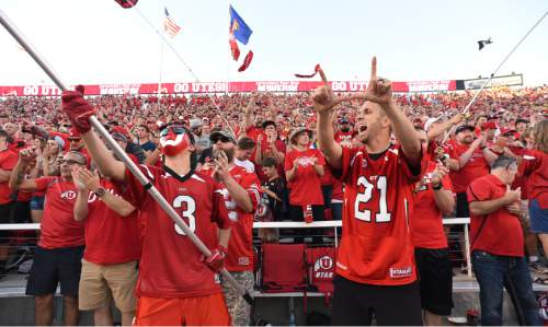Francisco Kjolseth | The Salt Lake Tribune Utah fans cheer on the team as they battle the Michigan Wolverings in game action at Rice Eccles Stadium on Thursday, Sept. 3, 2015.