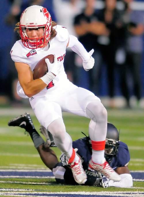 Southern Utah wide receiver Brady Measom gets tripped up by Utah State cornerback Daniel Gray during an NCAA college football game Thursday, Sept. 3, 2015, in Logan, Utah. (Eli Lucero/Herald Journal via AP)
