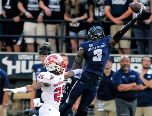 Utah State wide receiver Devonte Robinson (3) reaches out for an overthrown ball as Southern Utah's Josh Thornton defends during an NCAA college football game Thursday, Sept. 3, 2015, in Logan, Utah. (Eli Lucero/Herald Journal via AP)