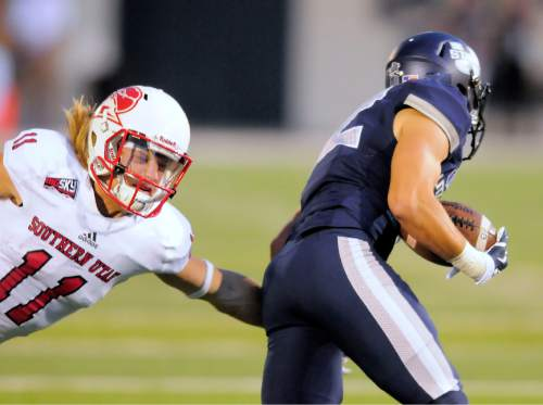 Southern Utah's Mike Sharp reaches out to try to tackle Utah State's Andrew Rodriguez on a punt return during an NCAA college football game Thursday, Sept. 3, 2015, in Logan, Utah. (Eli Lucero/Herald Journal via AP)