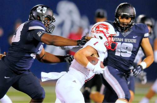 Southern Utah wide receiver Brady Measom (1) carries the ball as Utah State linebacker sMichael Okonkwo (23) and Ian Togiai (19) pursue during an NCAA college football game Thursday, Sept. 3, 2015, in Logan, Utah. (Eli Lucero/The Herald Journal via AP)