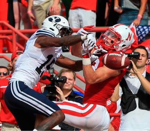 BYU defensive back Michael Davis (15) breaks up a pass intended for Nebraska wide receiver Lane Hovey (13) during the first half of an NCAA college football game in Lincoln, Neb., Saturday, Sept. 5, 2015. (AP Photo/Nati Harnik)