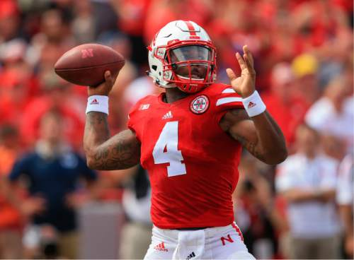 Nebraska quarterback Tommy Armstrong Jr. (4) throws during the first half of an NCAA college football game against BYU in Lincoln, Neb., Saturday, Sept. 5, 2015. (AP Photo/Nati Harnik)
