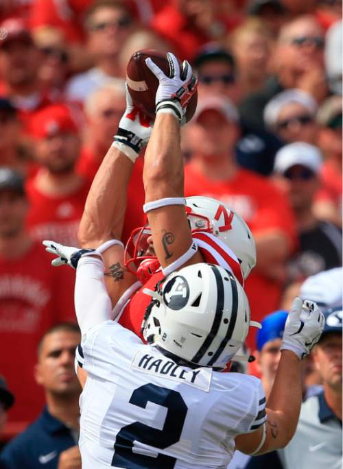 Nebraska wide receiver Jordan Westerkamp (1) makes a catch over BYU linebacker Troy Hinds (2) during the first half of an NCAA college football game in Lincoln, Neb., Saturday, Sept. 5, 2015. (AP Photo/Nati Harnik)