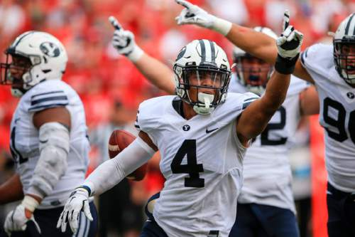 BYU linebacker Fred Warner (4) celebrates after recovering a fumbled ball for a turnover during the first half of an NCAA college football game against Nebraska in Lincoln, Neb., Saturday, Sept. 5, 2015. (AP Photo/Nati Harnik)