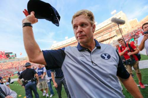 BYU head coach Bronco Mendenhall acknowledges fans as he walks off the field following an NCAA college football game against Nebraska in Lincoln, Neb., Saturday, Sept. 5, 2015. BYU won 33-28. (AP Photo/Nati Harnik)