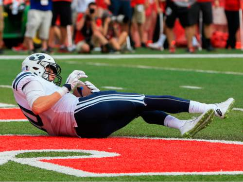BYU wide receiver Mitch Mathews (10) scores a touchdown against Nebraska during the first half of an NCAA college football game in Lincoln, Neb., Saturday, Sept. 5, 2015. (AP Photo/Nati Harnik)