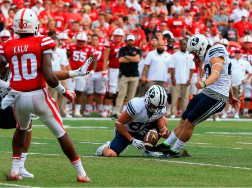 BYU kicker Trevor Samson, right, kicks an extra point as Nebraska cornerback Joshua Kalu (10) watches, during the first half of an NCAA college football game in Lincoln, Neb., Saturday, Sept. 5, 2015. (AP Photo/Nati Harnik)