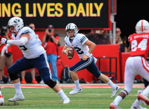 In this Sept. 5, 2015 photo, BYU quarterback Tanner Mangum (12) runs with the ball during the first half of an NCAA college football game against Nebraska in Lincoln, Neb. Taysom Hill's third season-ending injury in four years leaves freshman Tanner Mangum to lead BYU through an ambitious schedule that won't ease up any time soon. (AP Photo/Nati Harnik)