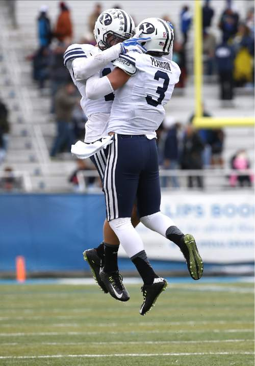 "Courtesy  |  Mark A. Philbrick, BYU BYU quarterback Christian Stewart celebrates a 1st Quarter touchdown with Colby Pearson. BYU defeated Middle Tennessee by a score of 27-7 at Johnny ""Red"" Floyd Stadium in Murfreesboro, Tenn., Saturday, Nov. 1, 2014."