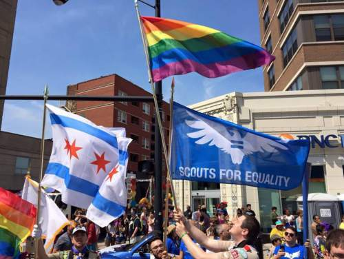In this Sunday, June 28, 2015 photo provided by Chris Zelis, Scouts For Equality - Chicago chapter members serve as the color guard for the Chicago Pride Parade. The lifting of the Boy Scouts of America's ban on gay adult leaders prompted some gay Eagle Scouts to quickly rejoin the movement on Tuesday, July 28, 2015. (Chris Zelis via AP)