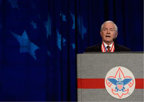 FILE - In this Friday, May 23, 2014 file photo, former Defense Secretary Robert Gates addresses the Boy Scouts of America's annual meeting in Nashville, Tenn., after being selected as the organization's new president. On Thursday Gates said that the organization's longstanding ban on participation by openly gay adults is no longer sustainable, and called for change in order to avert potentially destructive legal battles. (AP Photo/Mark Zaleski, File)