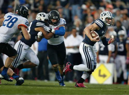 Scott Sommerdorf      The Salt Lake Tribune BYU QB Taysom Hill runs for a 20 yard TD to gibe BYU and 7-0 lead. BYU held a 24-3 lead over Boise State, Friday, October 25, 2013
