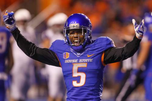 Boise State cornerback Donte Deayon (5) works up the crowd between plays during the second half of an NCAA college football game against Washington in Boise, Idaho, on Friday, Sept. 4, 2015. Boise State won 16-13. (AP Photo/Otto Kitsinger)