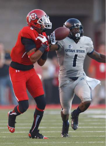Trent Nelson  |  The Salt Lake Tribune  Utah State Aggies cornerback Nevin Lawson (1) was called for pass interference on this pass to Utah Utes wide receiver Dres Anderson (6) reaches for the pass as the University of Utah hosts Utah State, college football Thursday, August 29, 2013 at Rice-Eccles Stadium in Salt Lake City.