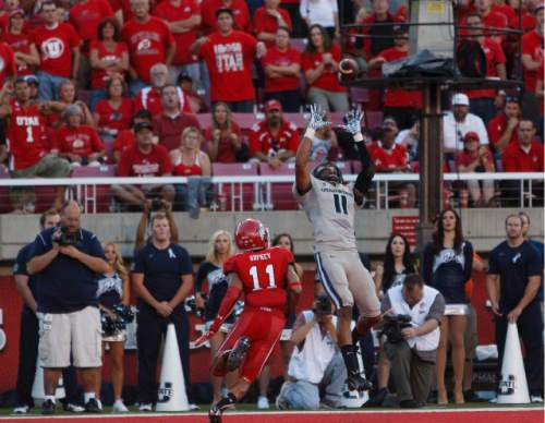 Trent Nelson  |  The Salt Lake Tribune  Utah State Aggies wide receiver Brandon Swindall (11) pulls down a touchdown pass, defended by Utah Utes defensive back Davion Orphey (11) as the University of Utah hosts Utah State, college football Thursday, August 29, 2013 at Rice-Eccles Stadium in Salt Lake City.