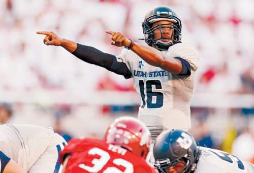 Trent Nelson  |  The Salt Lake Tribune Utah State Aggies quarterback Chuckie Keeton (16) controlling the offense on a touchdown drive as the University of Utah hosts Utah State, college football Thursday, August 29, 2013 at Rice-Eccles Stadium in Salt Lake City.