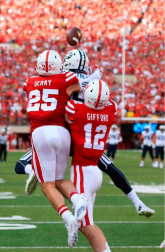 BYU wide receiver Mitch Mathews (10) catches the game winning touchdown in front of Nebraska safety Nate Gerry (25) and linebacker Luke Gifford (12) during the second half of an NCAA college football game in Lincoln, Neb., Saturday, Sept. 5, 2015. Brigham Young won 33-28. (AP Photo/Nati Harnik)