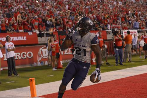 Leah Hogsten  |  The Salt Lake Tribune Utah State Aggies running back LaJuan Hunt (21) makes a touchdown. University of Utah is tied with Utah State 14-14 at halftime at Rice-Eccles Stadium, Friday, September 11, 2015.