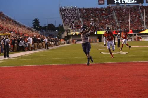 Leah Hogsten     The Salt Lake Tribune Utah State Aggies running back LaJuan Hunt (21) makes a touchdown. University of Utah is tied with Utah State 14-14 at halftime at Rice-Eccles Stadium, Friday, September 11, 2015.