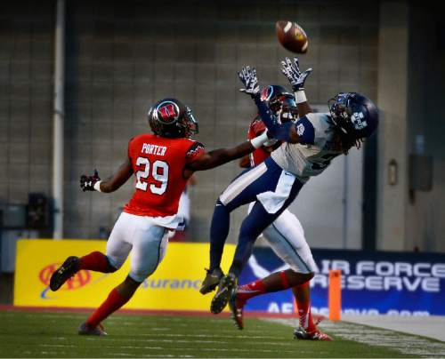 Scott Sommerdorf      The Salt Lake Tribune USU WR Devonte Robinson catches this long pass to help set up a USU TD. Utah and Utah State were tied 14-14 at the half at Rice-Eccles, Friday, September 11, 2015.