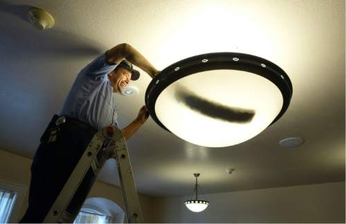 Lennie Mahler  |  The Salt Lake Tribune  A worker at the newly-restored LDS Tabernacle in Manti, Utah, cleans a light fixture on Friday, Sept. 11, 2015. The Tabernacle will be open to the public for viewing Saturday and Sunday from 3-7 p.m.