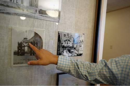 Lennie Mahler  |  The Salt Lake Tribune  Facilities Manager Matt Christensen shows a display case containing photos of the Manti Tabernacle in the late 1800s. The Tabernacle will be open to the public for tours Saturday and Sunday from 3-7 p.m.