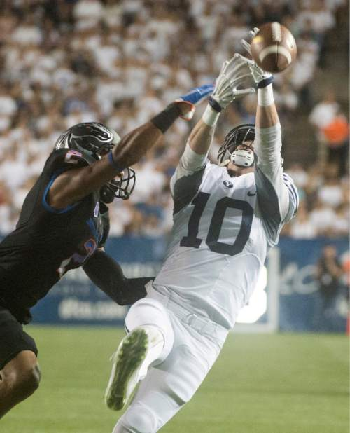Rick Egan  |  The Salt Lake Tribune  Brigham Young Cougars wide receiver Mitch Mathews (10) lets the pass slip through his hands, as Boise State Broncos cornerback Jonathan Moxey (2) defends, in college football action, BYU vs. Boise State at Lavell Edwards Stadium, Saturday, Sept. 12, 2015.