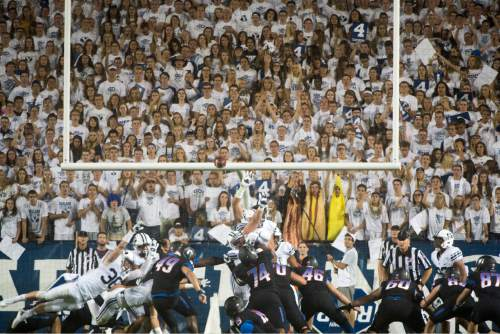 Rick Egan  |  The Salt Lake Tribune  Boise State Broncos place kicker Tyler Rausa (49)kicks a field goal giving Boise a 10-7 lead at the half, in college football action, BYU vs. Boise State at Lavell Edwards Stadium, Saturday, Sept. 12, 2015.