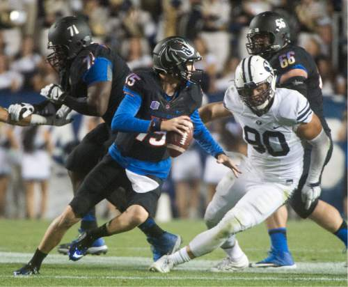 Rick Egan  |  The Salt Lake Tribune  Boise State Broncos quarterback Ryan Finley (15), scrambles to get away from Brigham Young Cougars defensive lineman Bronson Kaufusi (90), in college football action, BYU vs. Boise State at Lavell Edwards Stadium, Saturday, September 12, 2015.