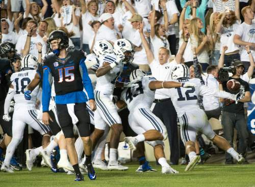 Rick Egan  |  The Salt Lake Tribune  Boise State Broncos quarterback Ryan Finley (15) reacts as Brigham Young Cougars defensive back Kai Nacua (12) celebrates scoring a touchdown on an interception, with just seconds remaining on the clock, in college football action, BYU vs. Boise State at Lavell Edwards Stadium, Saturday, September 12, 2015.