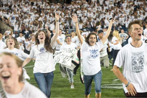 Rick Egan  |  The Salt Lake Tribune  Brigham Young fans storm the field as BYU upsets Boise State on two touchdowns in the last minute of play to beat the Broncos 35-24, in college football action, BYU vs. Boise State at Lavell Edwards Stadium, Saturday, September 12, 2015.