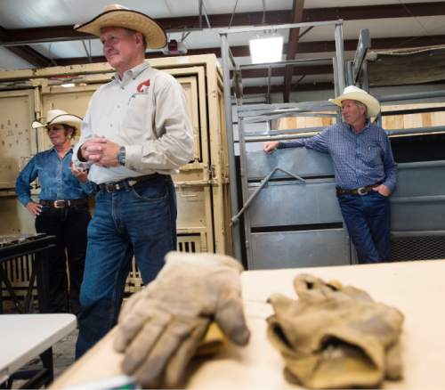 Steve Griffin     The Salt Lake Tribune  Gus Warr, left, of the Utah Wild Horse and Burro Program,  explains the chute system at the BLM's new off-range contract wild horse corral, located on a 32-acre private ranch in Axtell, Utah Monday, September 14, 2015.  Over 500 wild horses currently are housed at the facility, including the 170 wild horses associated with the Wheeler Pass Herd Management Area Emergency Gather near the Cold Creek area of Southern Nevada. The Axtell, Utah contract off-range corral can provide care for up to 1,000 wild horses and encompasses 32 acres of private land containing over 40 holding pens in various sizes.