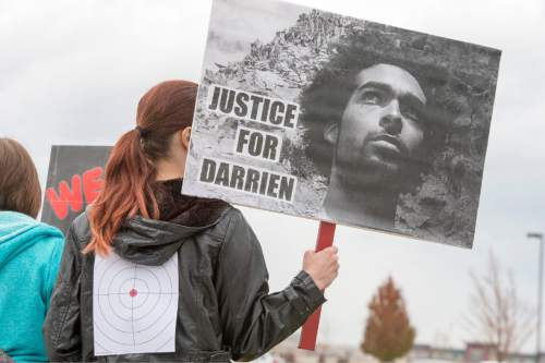 Rick Egan  |  The Salt Lake Tribune  Supporters chant during a rally fin Saratoga Springs, for Darrien Hunt, who was fatally shot by two Saratoga Springs police officers on Sept. 10, 2014, after allegedly swinging a samurai-type sword at the officers.Friday, November 14, 2014